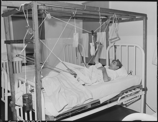 lossy-page1-618px-Hugh_Pierce,_miner,_in_hospital,_with_broken_leg_caused_by_slate_fall_in_mine_Sept._4th._Black_Mountain_Corporation..._-_NARA_-_541254.tif