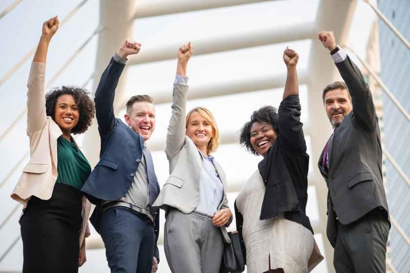 five people raising hands